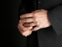 29449009 - mature man taking off his golden wedding ring, close-up on hands