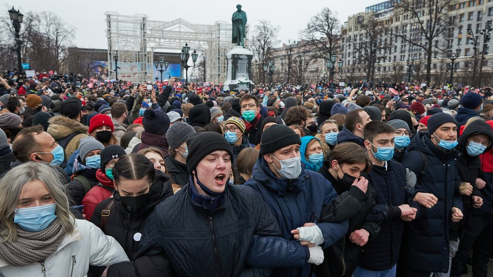 People attend a rally in support of jailed opposition leader Alexei Navalny in Moscow